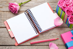 Blank notepad and gift box full of pink roses Stock Photography