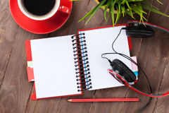 Blank notepad, headphones and coffee Stock Image