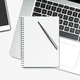 Blank notepad and laptop Stock Photos