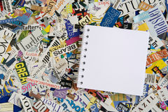Blank Notepad on Magazine Clipping Background. Blank notepad with copy space on magazine clipping background Stock Image