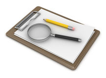 Blank Notepad and Magnify Glass Royalty Free Stock Photography