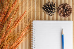 blank notepad notebook with pencil on brown bamboo background Royalty Free Stock Images