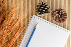 blank notepad notebook with pencil on brown bamboo background Royalty Free Stock Photos