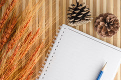 Blank notepad notebook with pencil on brown bamboo background Stock Photography