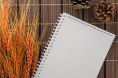 blank notepad notebook with pencil on brown bamboo background Stock Photo