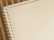 Blank notepad notebook with pencil on brown bamboo background Stock Images