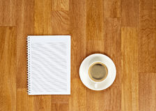 Blank notepad with office supplies and cup of coffee on wooden t Royalty Free Stock Photos