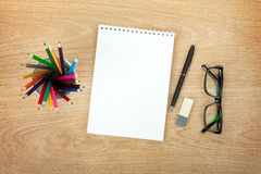 Blank notepad with office supplies and glasses Royalty Free Stock Photo
