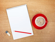 Blank notepad with office supplies and red coffee cup Royalty Free Stock Images
