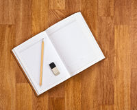Blank notepad with office supplies on wooden table. Royalty Free Stock Photos