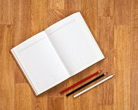 Blank notepad with office supplies on wooden table. Stock Image