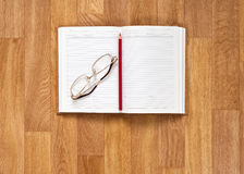 Blank Notepad with Office Supplies on Wooden Table. Royalty Free Stock Photo