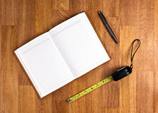 Blank Notepad with Office Supplies on Wooden Table. Royalty Free Stock Image