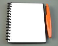 Blank notepad with orange pen Stock Image