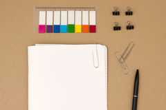 Blank notepad with organizing supplies Stock Photos