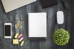 Blank notepad and other objects Stock Photography