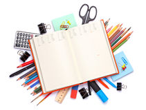 Blank notepad over school and office supplies on office table Royalty Free Stock Photos
