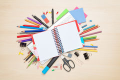 Blank notepad over school and office supplies Royalty Free Stock Image
