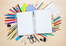 Blank notepad over school and office supplies Stock Photography