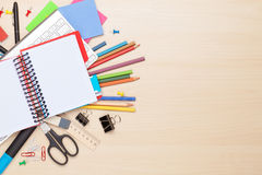 Blank notepad over school and office supplies Stock Images