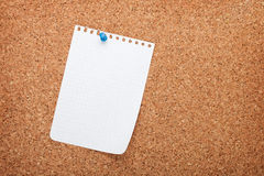 Blank notepad paper on cork wood notice board. With copy space royalty free stock image