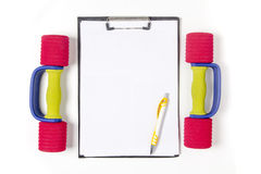 Blank notepad paper and pen and dumbbell, Stock Photos