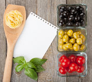 Blank notepad paper for recipes. And fruits on wooden table Stock Photos