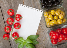 Blank notepad paper for recipes and fruits. On wooden table Stock Photo