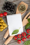 Blank notepad paper for your recipes and food. On wooden table Royalty Free Stock Photos