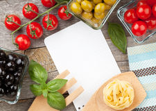 Blank notepad paper for your recipes and food. On wooden table Royalty Free Stock Photo