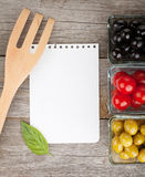 Blank notepad paper for your recipes and fruits. On wooden table Stock Photography