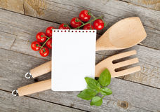 Blank notepad paper for your recipes. With tomatoes and basil on wooden table Royalty Free Stock Image