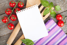 Blank notepad paper for your recipes with tomatoes and basil royalty free stock photography