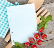 Blank notepad paper for your recipes with tomatoes and basil Stock Photo