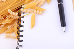Blank notepad with pasta Stock Photography