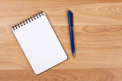 Blank notepad with pen. On wood table royalty free stock photos