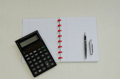Blank notepad with pen and calculator Stock Image