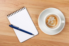 Blank notepad with pen and empty coffee cup Royalty Free Stock Photography