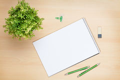 Blank notepad, pen and flower on wooden table Stock Photos