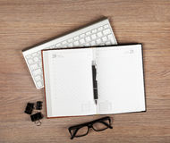 Blank notepad with pen and glasses Royalty Free Stock Photos