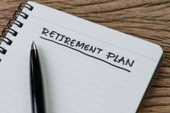 Blank notepad with pen and handwriting important headline as Retirement Plan on wood table, planning for saving and investment. For the after retire life royalty free stock images