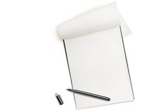 Blank notepad with pen isolated on white. Free space for text stock image