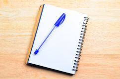 Blank notepad with pen Stock Photography
