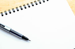 Blank notepad with pen Stock Image