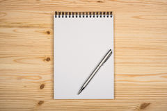 Blank notepad with pen. On office wooden table Stock Photo