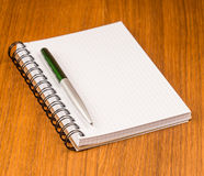 Blank notepad with pen Stock Photos
