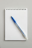 Blank notepad with pen on office wooden table Royalty Free Stock Photo