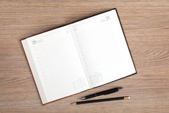 Blank notepad with pen and pencil Stock Photos