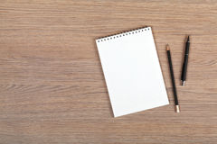 Blank notepad with pen and pencil Royalty Free Stock Photos