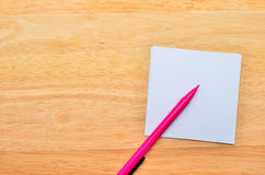 Blank notepad with pen Stock Images